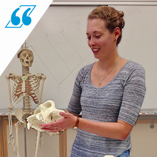 Meagan Vakiener, a PhD Student in Human Paleobiology, holds a primate skull