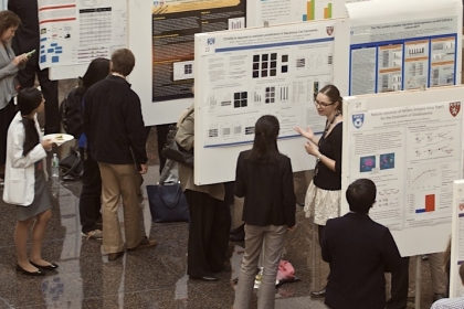 Rows of students presenting academic posters