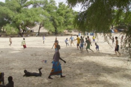 Students playing soccer with the locals in the dried up Il Eriet river in 2007.