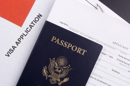 US passport on top of a visa application