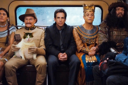 The main characters of Night of at the Museum in the back of a car